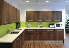 A splash of lime green is added to the kitchen area