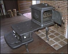 vintage garland stove - more than likely a laundry room stove from a well to do family. Antique Wood Stove, How To Antique Wood, Vintage Wood, Outdoor Wood Furnace, Wood Stove Cooking, Old Stove, Cast Iron Stove, Vintage Stoves, Wood Burner