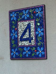 Mosaic house number  By artist Madeleen Willer#Repin By:Pinterest number 4 surrounded by blue daisy pattern