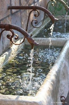 Running water can be so soothing that it must be almost therapeutic to have a rustic fountain like this one in the yard. With all the local auctions during the spring and early summer, it might not be difficult to locate two old marble planters and old gate pieces to recreate this look. It's not fussy or formal in the least and it also isn't some ready-made bit from the garden store that you'd see all over the neighborhood. Architectural Landscape Design