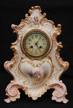 19th century French porcelain mantle clock. The Limoges porcelain case with ornate hand painted gilding and courting scenes.
