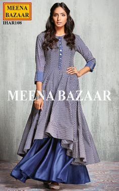 Give your ethnic avatar a vibrant definition this season with this voguish Asymmetrical cut anarkali suit. Meticulously and beautifully pin tucks on net and cuffs with ethnic coin buttons on neckline and placket shows a touch of traditional charm. Comes with matching modal silk flarred palazzo.