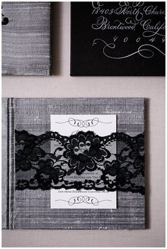 Silk invitations made of silver dupioni with a black embroidered monogram. These luxurious wedding invitations were engraved with a beveled and hand painted edge.   Our lace custom invitations come with lace bands to hold in the inserts. Please to click on the photo to see all of the details or pin to save for later!