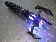 The Viper. A custom-designed saber from SaberForge. I plan on having this with just two claws (180° from each other) and a deep red blade. Gonna let my inner Sith out with this one ;).