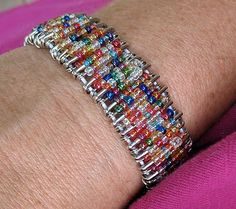 Remember friendship pins from when you were a kid? Turn them into a bracelet!! Fun!!