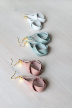 Leather knot earrings in Pastels + + + by casuallynatural See related items on Fanatic Leather Store. #earringsprojects