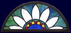 indian feather arched stained glass transom at aglassmenagerie.net/southwest.html