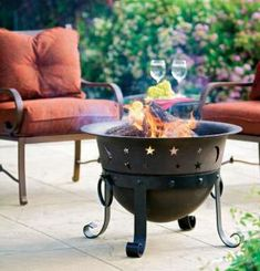 Catalina Creations Celestial Cauldron fire pit, cast iron with black steel stand. Includes spark screen. $219 at Home Depot, www.homedepot.com.