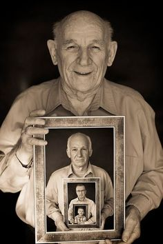 Generation photo..  Great grandpa holding picture of grandpa holding picture of dad holding picture of kid.  AWESOME,