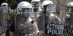 Greek police 'Photoshop away' signs of brutality from mugshots | Amnesty International