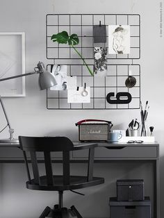 Wired bulletin board in a grey + black home office