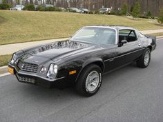This was, so far, my favorite car ~~ black, tan leather seats, custom pinstriping ~~ awww...miss it.