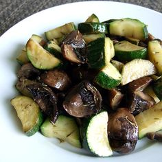 Roasted Zucchini and Mushrooms....I added onions and it smells amazing in the oven! Make sure to salt the zucchini slices, lay on paper towel and allow a few minutes for juices to come out....then blot with towel. ( I learned this a few years ago and it cooks a lot better)