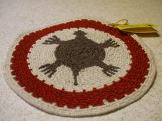 """""""TURTLE"""" table or wall mat created using coiled basketry technique with wool yarn. Poetry card attached. Created by Susan Richardson of Desert Mojo Designs"""