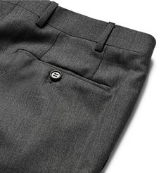 If you're in need of a pair of quality trousers for the office, look no further than Italian tailoring experts <a href='http://www.mrporter.com/mens/Designers/Canali'>Canali</a>. Cut in a comfortable slim fit from lightweight anthracite wool, this traditional 'Milano' pair is designed with five pockets and unfinished hems so you can tailor them to the desired length.