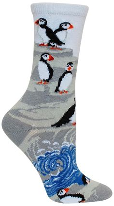 Light colored crew length socks with Atlantic puffins on rocks with ocean waves splashing against them. Fits a women's shoe size 6-8.5. Puffins on the Rocks socks are made from 75% Cotton, 20% Nylon,