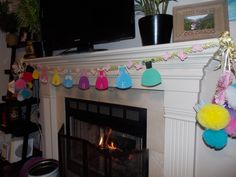 Name banner I designed and put together, with 2 chandeliers on either side of the fireplace!