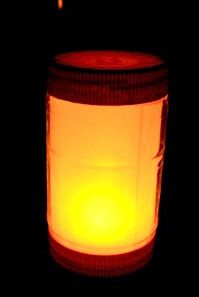 plastic peanut butter jar made into a lantern; found at Made By Cynthia