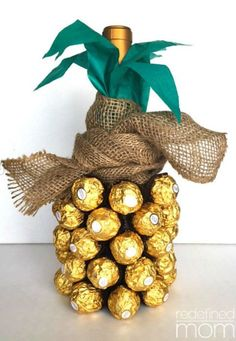 DIY Wine Pineapple: For a quick hostess gift, make this pineapple lookalike with a bottle of wine or sparkling cider, individually wrapped truffles, green tissue paper, and burlap. Find more fun, homemade, and affordable last minute Christmas gift ideas for mom, dad, sister, bother, friends and grandparents. here.