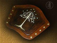 Hand Carved Leather Archery Bracer, Armguard. Tree of Gondor Design. | eBay  http://www.ebay.co.uk/itm/Hand-Carved-Leather-Archery-Bracer-Armguard-Tree-of-Gondor-Design-/321334912411?pt=UK_Archery&hash=item4ad10da59b