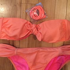 Orange bandeau top bottom and removable straps Worn maybe twice matching orange top and bottom Victoria's Secret Swim Bikinis