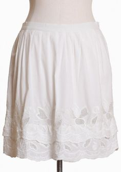 a petit blossoms white applique skirt $42.99  A darling white as snow skirt with two scalloped tiers at the bottom wrapped with a cutout floral applique. Has slight pleating along the top, and zips open on the side. Fully lined.