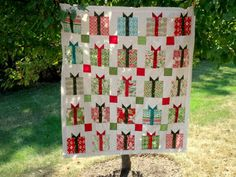 LuAnn's fabulous Charm Pack version of the Flurry Quilt.  She has a tutorial on her blog on using the charms instead of the layer cake originally required on the pattern.