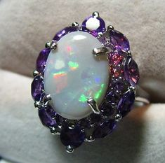 Sterling silver, fire opal and amethyst ring - Way more bling than I ever wear, but it's stunning!