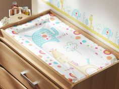 The new wipe-clean Tiddly Wink Safari changing mattress! Fun and bright! #changingmat #nursery