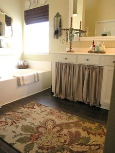 burlap curtain under kitchen sink...one cabinet door is pretty warped...perhaps get rid of and do this...