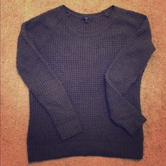 Cozy and stylish dark gray sweater Cozy gray dark sweater. Perfect for colder weather paired with your favorite jeans and scarf! Worn but like new! GAP Sweaters Crew & Scoop Necks