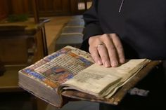 Close up of that stunning Bible in the Archbishop's hands.