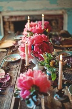 Rustic table,  peonies line the center,  candlelight .