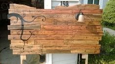 Headboard made from Wooden Pallets with painted or stenciled design and a built in sconce...love, love, love this one!!!
