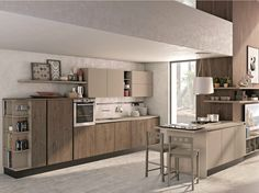 Cucina componibile con penisola senza maniglie KYRA NECK by CREO Kitchens by Lube