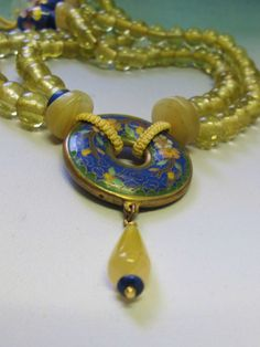 Necklace of vintage golden Peking glass beads with lapis and a vintage cloisonné Pi.