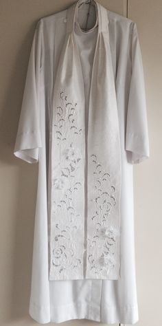Great for weddings. Made from pure dupioni silk with cut work embroidery. Embellished with pearls and organza flowers