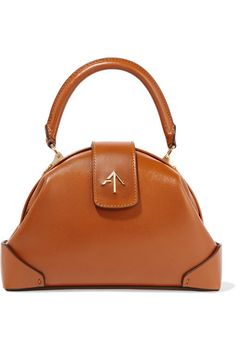 Tan leather (Calf) Snap-fastening top flap  Comes with dust bag Weighs approximately 1.3lbs/ 0.6kg