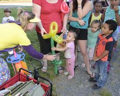 """Balloon artist Linda Pettis of Averill Park, also known as """"Cloudy,"""" creates a variety of objects and animals during the National Night Out event held at the Burden Iron Works Museum in South Troy Tuesday evening. Carras / The Record) Balloon Animals, Block Party, Find Someone Who, Night Out, Balloons, Law Enforcement, Troy, Tuesday, Objects"""