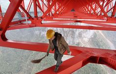 World's highest bridge meets the world's most lax 'elf and safety rules: Daredevil Chinese workers put finishing touches to amazing new structure