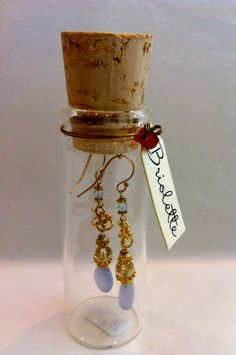 Cute idea for gift. Also could be a good way to travel with earrings!