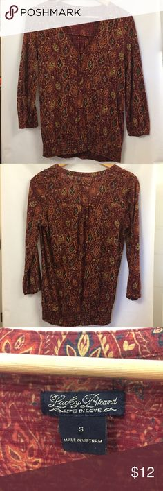 • Lucky Brand • Paisley Dark Red Peasant Top Comfortable long sleeve top with button cuffs and paisley print all over. Split neckline with three small buttons down the front. Gently used with no apparent stains. Lucky Brand Tops