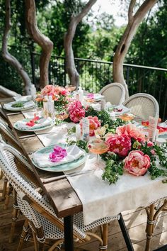 Spring garden party table set with peonies and Riviera Side Chairs.