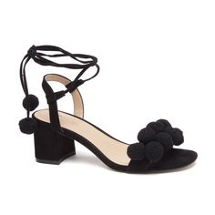 The Tansy Dress Sandals feature a thick strap across the toe detailed with soft pom poms, a mid height block heel, and thin ankle ties finished with pom poms on each tie.