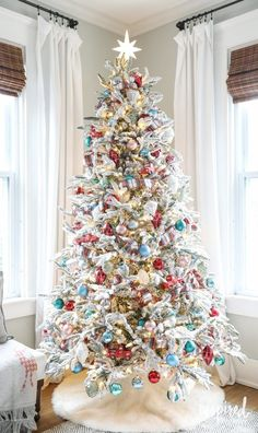 See how Inspired by Charm decorated his Fun, Festive, and Flocked Christmas Tree. Plus, tips and tricks for decorating a flocked Christmas tree. Flocked Christmas Trees Decorated, Creative Christmas Trees, Decoration Christmas, Christmas Tree Design, Beautiful Christmas Trees, Colorful Christmas Tree, Blue Christmas, Christmas Home, Christmas Holidays