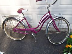 Purple 1960's Schwinn bike. Yep, that looks like the one my sister was riding. I was behind her on the flat fender swinging my feet as we were heading home. Bad move! Got my foot caught in the spokes and sprained my ankle. Ahhh, those were the days....