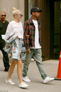 Kylie Jenner wearing Puma Basket Classic Sneakers, Gucci Embroidered Jacket…