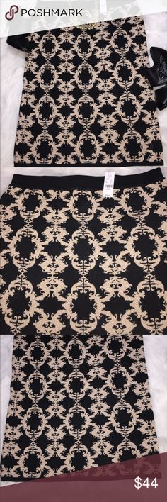 NWT New York & Company black sweater skirt Black scroll sweater skirt, size XLarge. Elastic waistband, hidden back zipper, split in back. 18 inch waist, 27 inches long. 73% rayon, 24% nylon and 3% metallic. Stretches. New York & Company Skirts Pencil
