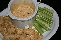 Buffalo Chicken Dip - Must use Frank's Buffalo sauce, cook & pull/shred chicken yourself (Never used canned chicken! Yucko!) and let chicken marinate in Frank's overnight...that makes a huge difference. Serve with Fritos scoops.