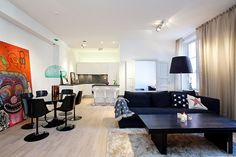 Diverse Three Room Apartment Inspiring a Pleasant Atmosphere in Stockholm